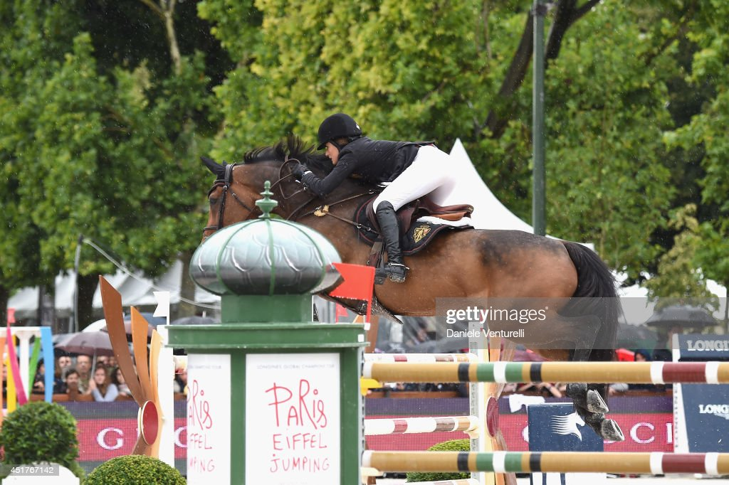 Jessica Springsteen rides Vindicat W during the 'Gucci Gold Cup Paris Eiffel Jumping Table A against the clock with jump-off' at the Paris Eiffel Jumping presented by Gucci at Champ-de-Mars on July 6, 2014 in Paris, France.