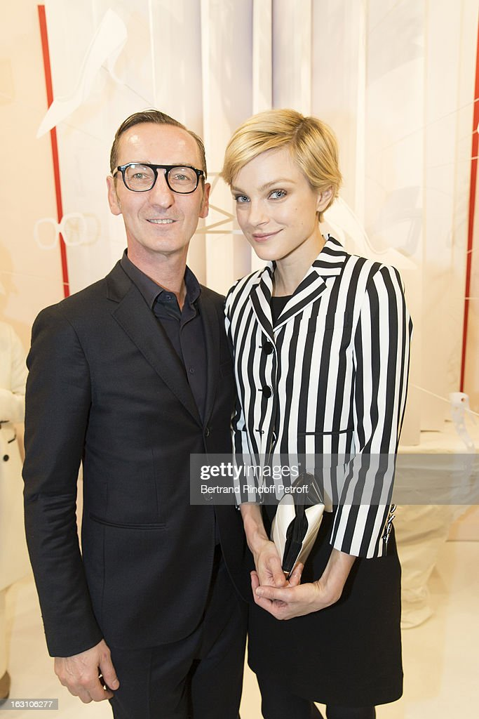 <a gi-track='captionPersonalityLinkClicked' href=/galleries/search?phrase=Jessica+Stam&family=editorial&specificpeople=657570 ng-click='$event.stopPropagation()'>Jessica Stam</a> (R) and Bruno Frisoni attend the Roger Vivier Cocktail, to celebrate the launch of the book 'Roger Vivier', as part of Paris Fashion Week on March 4, 2013 in Paris, France.
