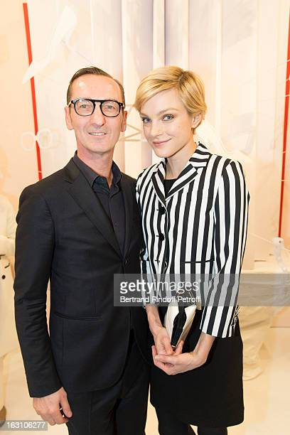 Jessica Stam and Bruno Frisoni attend the Roger Vivier Cocktail to celebrate the launch of the book 'Roger Vivier' as part of Paris Fashion Week on...
