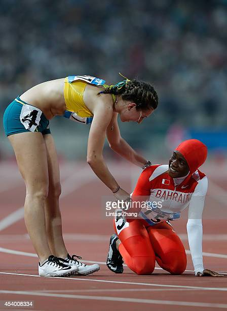 Jessica Thornton of Australia celebrates with Salwa Naser of Bahrain after the Women's 400m Final of Nanjing 2014 Summer Youth Olympic Games at the...