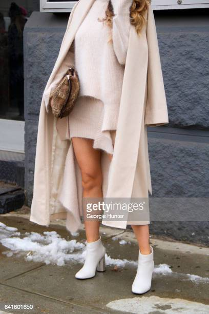 Jessica Wang is seen at Spring Studios outside the Lacoste show wearing draped nude wool knit outfit of skirt sweater and coat with flared sleeves...