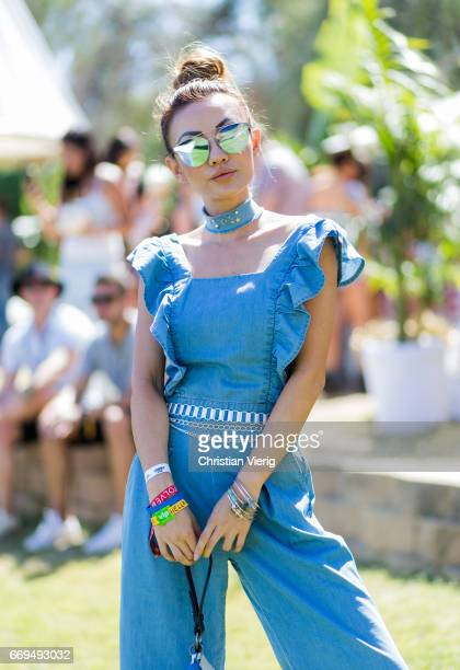 Jessica Wang wearing a blue jumsuiot at the Revovle Festival during day 3 of the 2017 Coachella Valley Music Arts Festival Weekend 1 on April 16 2017...