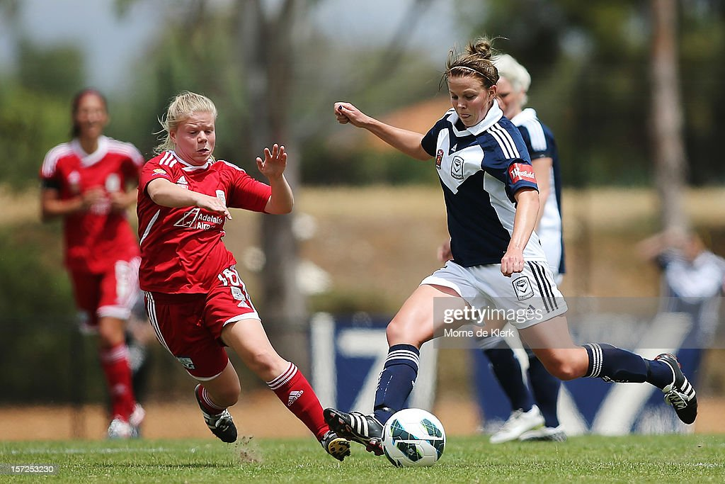 Jessica Waterhouse (L) of Adelaide competes with Amy Jackson (R) of Melbourne during the round seven W-League match between Adelaide United and the Melbourne Victory at Burton Park on December 1, 2012 in Adelaide, Australia.