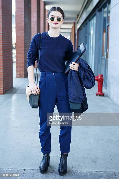 Jessica wears Other Stories shoes and handbag American Apparel trousers and UniQlo jumper on March 3 2015 in Madrid Spain