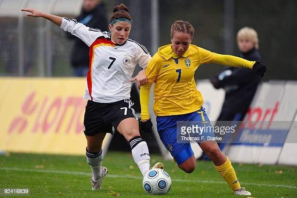 Jessica Wich of Germany and Malin Levenstad of Sweden tackle for the ball during the women's international friendly match between Germany U20 and...