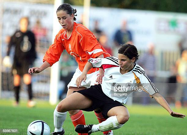 Jessica Wich of Germany competes with Mandy van den Berg of the Netherlands during the womens under 15 friendly match between Germany and the...