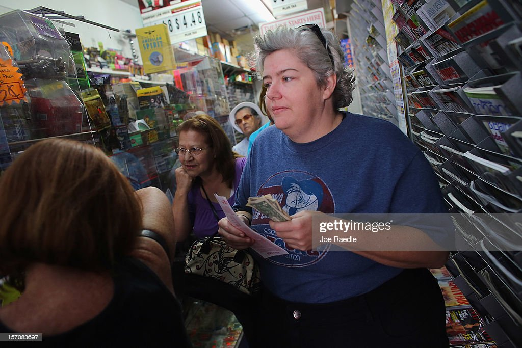 Jessica Young waits in line to buy Powerball tickets at Circle News Stand on November 28, 2012 in Hollywood, Florida. The jackpot for Wednesday's Powerball drawing is currently at $550 million which is the richest Powerball pot ever. It is likely to rise even more as people continue to buy before tonights drawing.