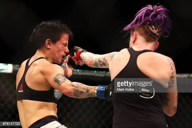 JessicaRose Clark of Australia is punched by Bec Rawlings of Australia in their women's flyweightbout during the UFC Fight Night at Qudos Bank Arena...