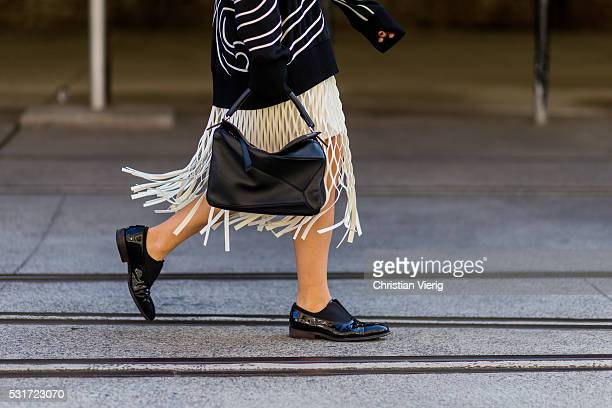 Jessie Bush wearing a black Stella McCartney sweater creme Dion Lee skirt with fringes and black Loewe handbag outside Ginger Smart at MercedesBenz...