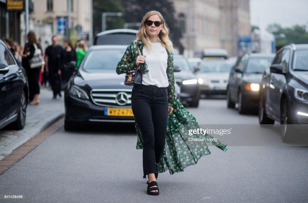 Jessie Bush wearing kimono, navy denim jeans, Gucci bag outside House of Dagmar on August 31, 2017 in Stockholm, Sweden.