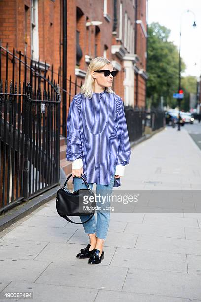 Jessie Bush wears Celine sunglasses a blue Creatures of Comfort striped shirt anklelength Sandro jeans Rupert Sanderson loafers and a Loewe bag...