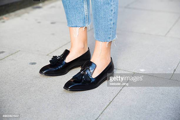 Jessie Bush wears Rupert Sanderson loafers Sandro anklelength jeans Fashion Week Spring Summer 2016 at Yeomanry House on September 19 2015 in London...