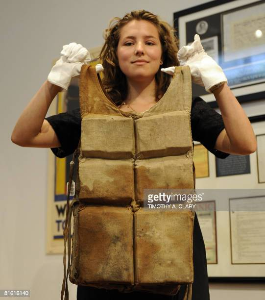 Jessie Edelman from Christie's holds up a never before seen in public life preserver from RMS Titanic on June 18 2008 that will be sold during the...