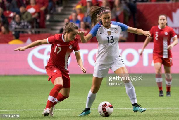 Jessie Fleming of Canada tries to check Alex Morgan of the United States during International Friendly soccer match action at BC Place on November 9...