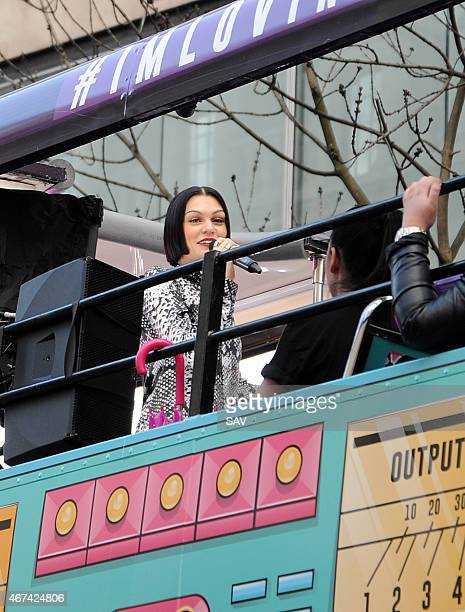 Jessie J performs on an open top bus for fans on March 24 2015 in London England