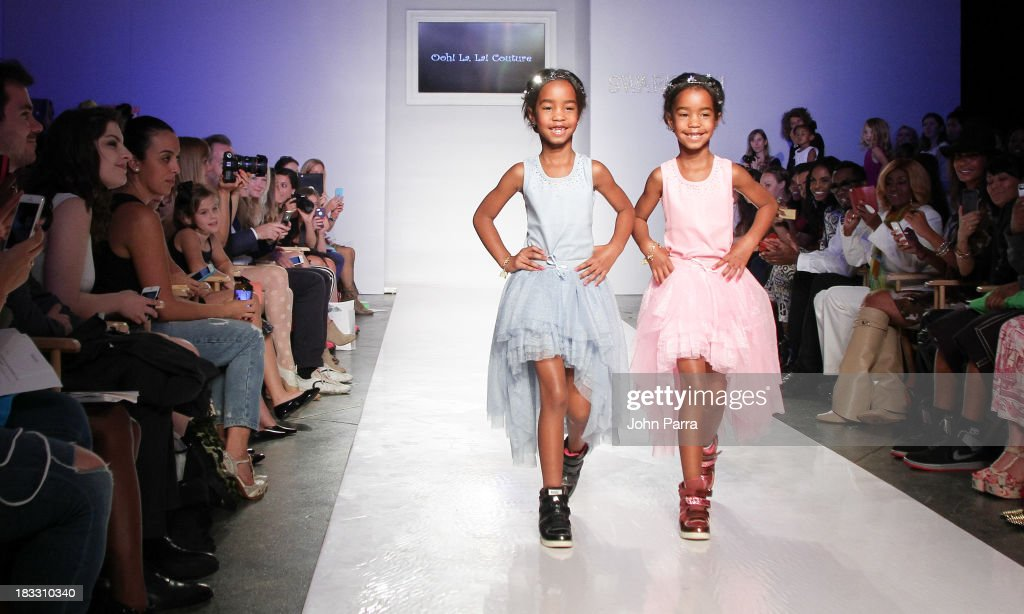 Jessie James Combs and D'Lila Star Combs walk the Ooh! La La! preview during the Swarovski at petiteParade NY Kids Fashion Week in Collaboration with VOGUEbambini on October 5, 2013 in New York City.