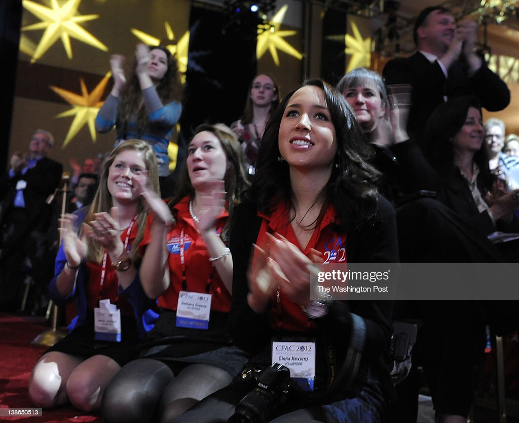 Jessie Jenkins, Bethany Green, and Elena Nevarez clap for Texas Governor Rick Perry at the 39th Annual CPAC Conference in Washington DC on Thursday, February 9, 2012.