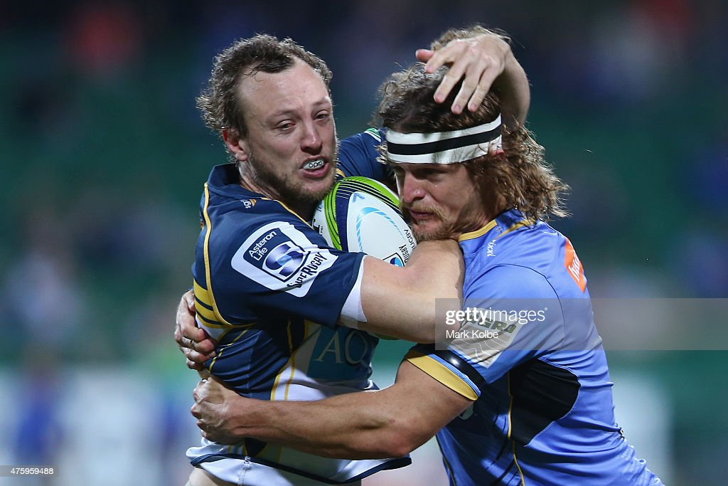 Jessie Mogg of the Brumbies is tackled by <a gi-track='captionPersonalityLinkClicked' href=/galleries/search?phrase=Nick+Cummins&family=editorial&specificpeople=4218998 ng-click='$event.stopPropagation()'>Nick Cummins</a> of the Force during the round 17 Super Rugby match between the Western Force and the Brumbies at nib Stadium on June 5, 2015 in Perth, Australia.
