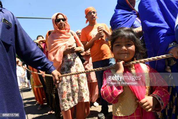 Jessie Singh middle and other Sikhs line up behind the float carrying the Guru Granth Sahib the Sikh holy book during the second annual American Sikh...