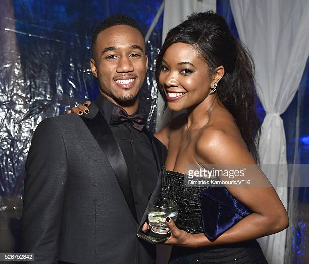 Jessie Usher and Gabrielle Union attend the Bloomberg Vanity Fair cocktail reception following the 2015 WHCA Dinner at the residence of the French...