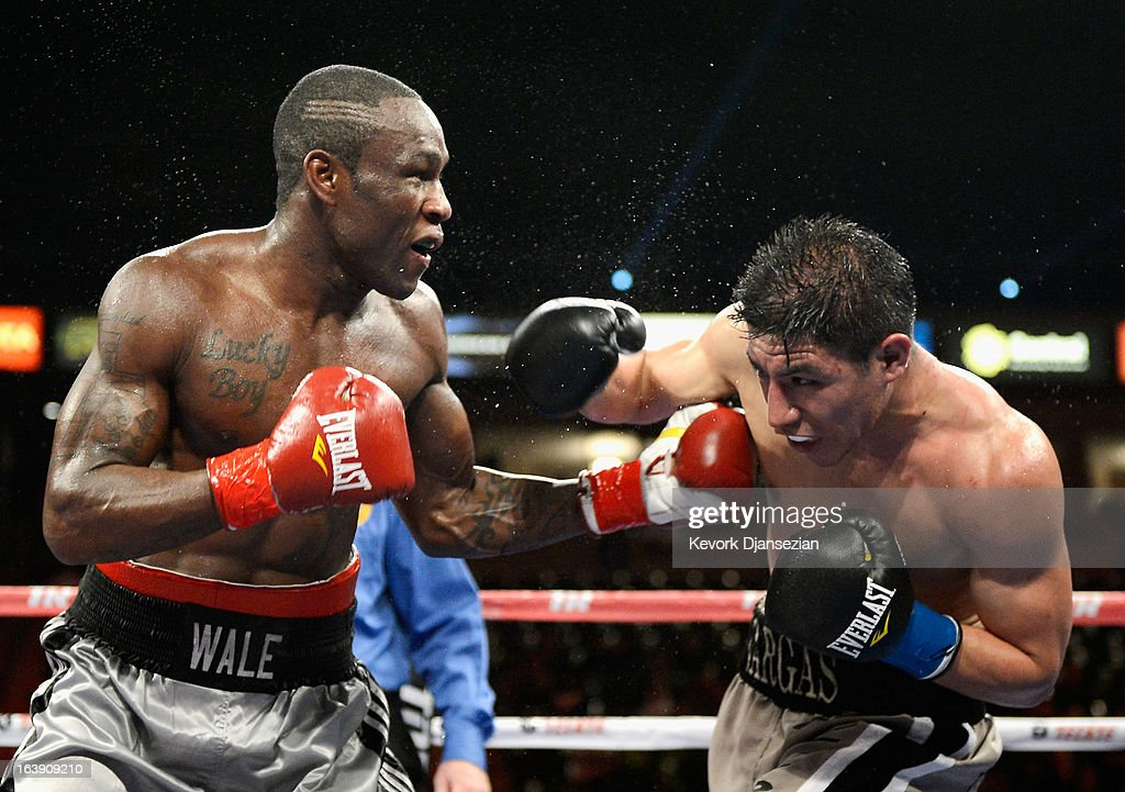Jessie Vargas (R) throws a punch against Wale 'Lucky Boy' Omotoso during their WBC continental americas welterweight title boxing match at The Home Depot Center on March 16, 2013 in Carson, California. Vargas won with a unanimous decision.
