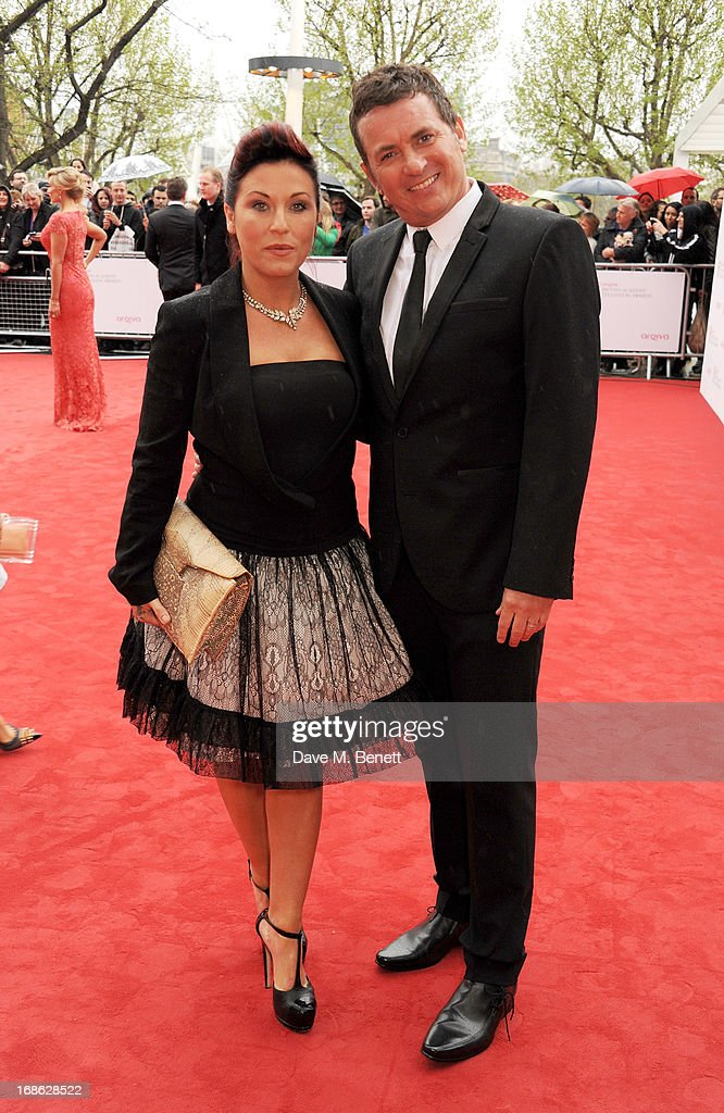 <a gi-track='captionPersonalityLinkClicked' href=/galleries/search?phrase=Jessie+Wallace&family=editorial&specificpeople=214004 ng-click='$event.stopPropagation()'>Jessie Wallace</a> (L) and <a gi-track='captionPersonalityLinkClicked' href=/galleries/search?phrase=Shane+Richie&family=editorial&specificpeople=206991 ng-click='$event.stopPropagation()'>Shane Richie</a> attend the Arqiva British Academy Television Awards 2013 at the Royal Festival Hall on May 12, 2013 in London, England.