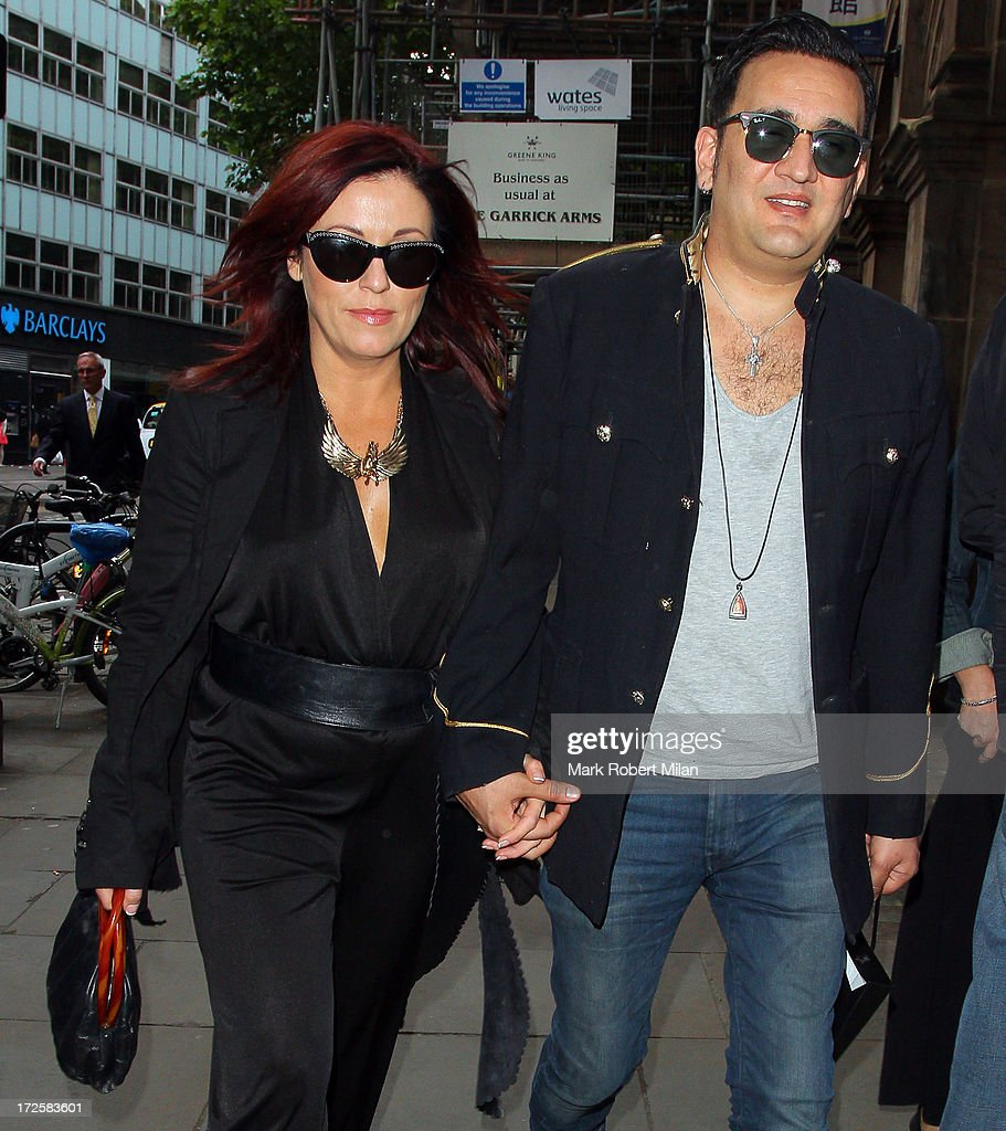 Jessie Wallace and Tim Arnold celebrate his birthday at the Rock Of Ages musical at the Garric theatre on July 3, 2013 in London, England.