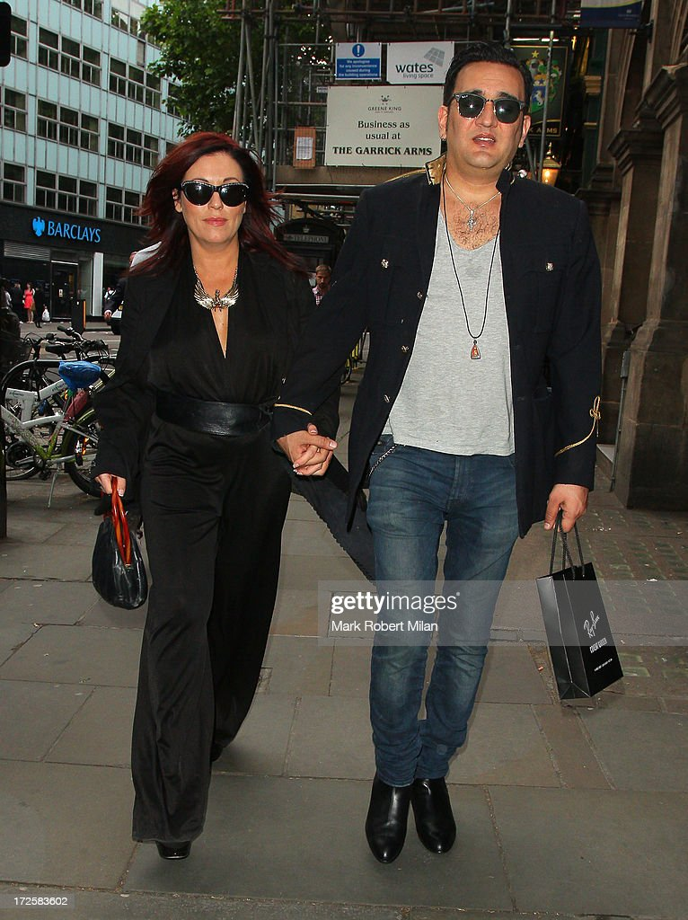 <a gi-track='captionPersonalityLinkClicked' href=/galleries/search?phrase=Jessie+Wallace&family=editorial&specificpeople=214004 ng-click='$event.stopPropagation()'>Jessie Wallace</a> and Tim Arnold celebrate his birthday at the Rock Of Ages musical at the Garric theatre on July 3, 2013 in London, England.