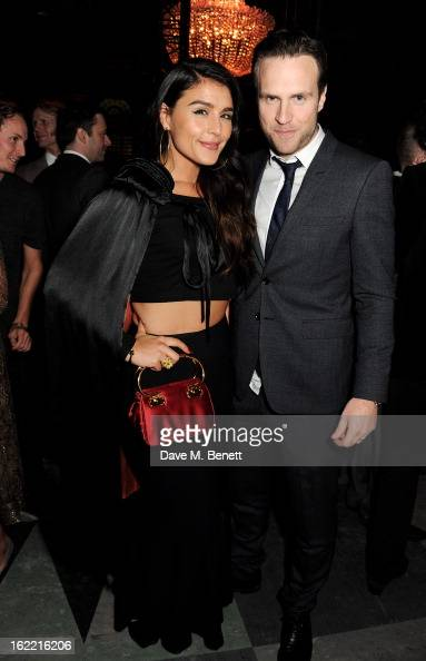 Jessie Ware and Rafe Spall attend the Universal Music Brits Party hosted by Bacardi at the Soho House popup on February 20 2013 in London England