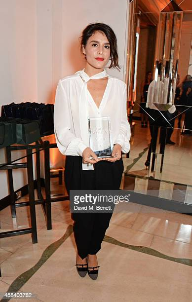 Jessie Ware winner of the Audemars Piguet Musician of the Year award poses at the Harper's Bazaar Women Of The Year awards 2014 at Claridge's Hotel...