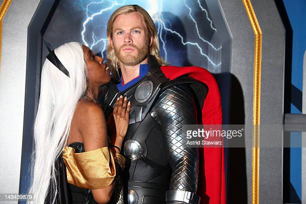 Jessie White poses with a wax figure of Thor as portrayed by actor Chris Hemsworth at the Madame Tussauds New York's Interactive Marvel Super Hero...