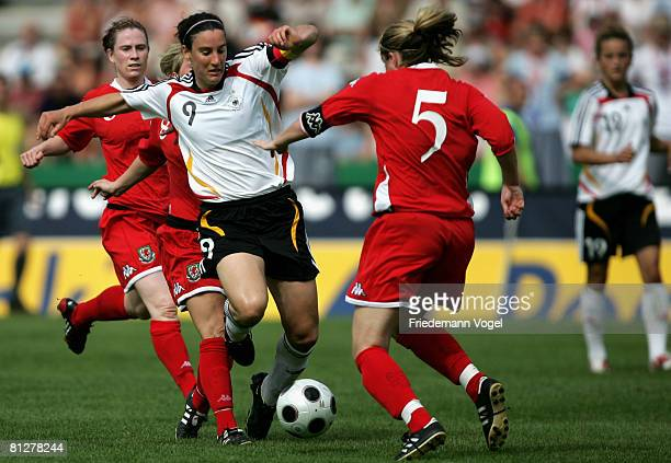 Jessika Fishlock and Emma Jones of Wales battles for the ball with Birgit Prinz of Germany during the Women's Euro 2009 qualifier between Germany and...