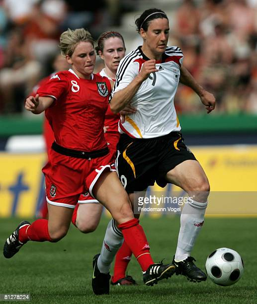Jessika Fishlock of Wales battles for the ball with Birgit Prinz of Germany during the Women's Euro 2009 qualifier between Germany and Wales at the...