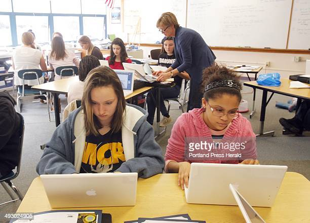 Jessy Brewer left and Kiara Neal work on their laptops in Ann Young's math class at King Middle School on Friday February 3 2012 The Maine Department...