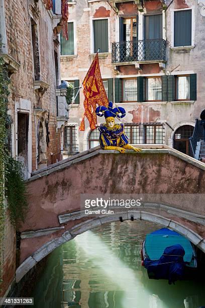Jester on bridge, Venice