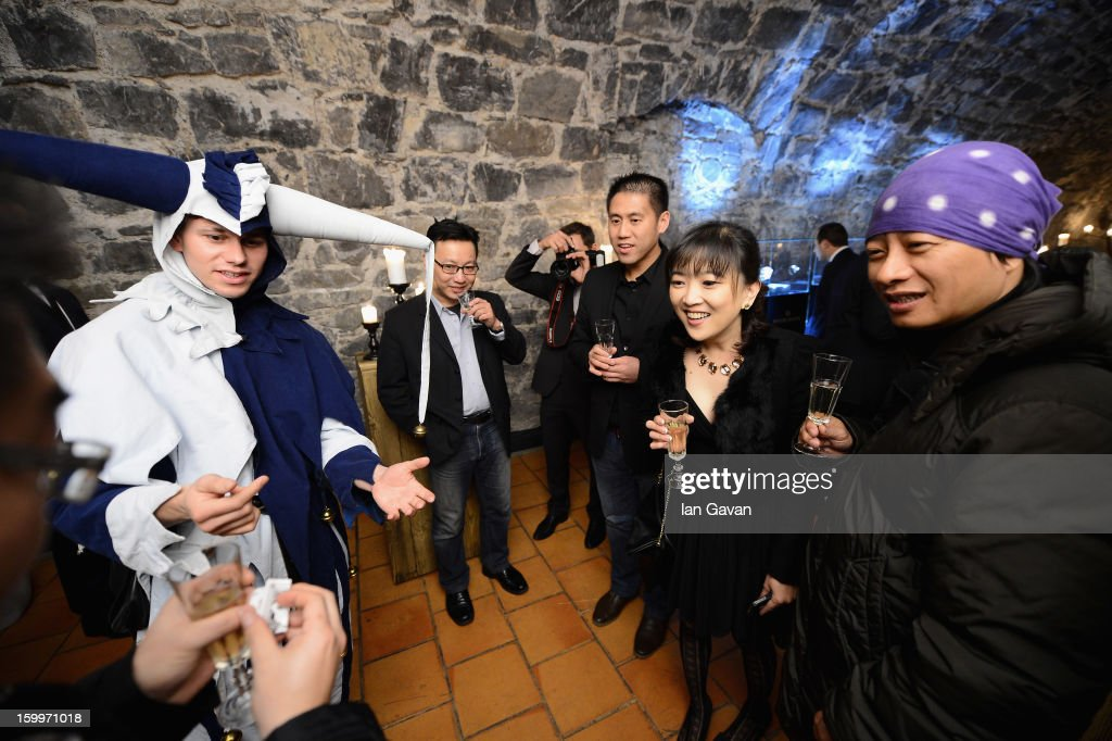 A jester performs a magic trick at the Excalibur Dinner hosted by Roger Dubuis during the 23rd Salon International de la Haute Horlogerie at Caves des Vollandes on January 23, 2013 in Geneva, Switzerland.