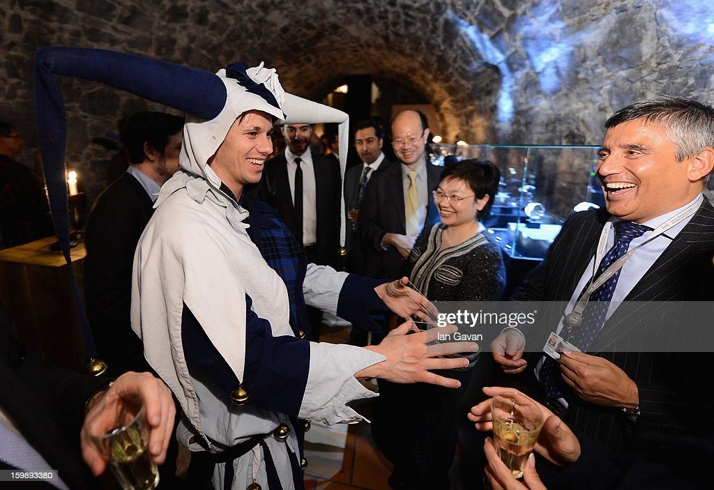 A jester performs magic tricks at the Excalibur Dinner hosted by Roger Dubuis during the 23rd Salon International de la Haute Horlogerie at Caves des Vollandes on January 21, 2013 in Geneva, Switzerland.