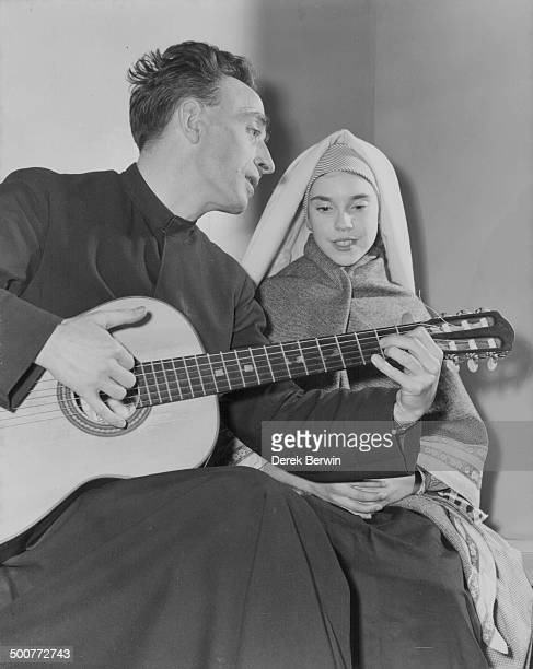 Jesuit priest guitarist Pere Aime Duval rehearsing at with schoolgirl Patricia Connor for a concert London February 3rd 1958