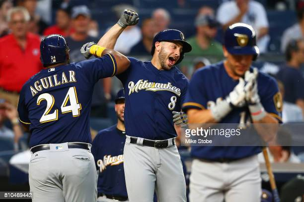 Jesus Aguilar of the Milwaukee Brewers celebrate with c after hitting a second inning 2run home run against the New York Yankees at Yankee Stadium on...