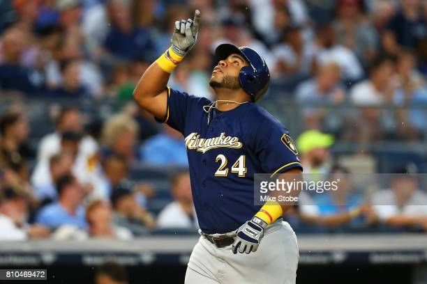 Jesus Aguilar of the Milwaukee Brewers celebrates after hitting a second inning 2run home run against the New York Yankees at Yankee Stadium on July...