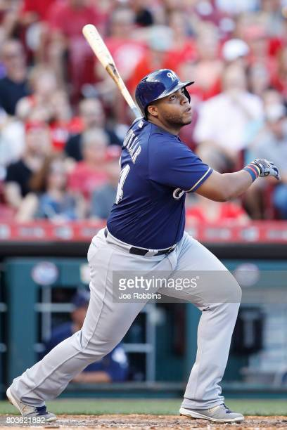 Jesus Aguilar of the Milwaukee Brewers doubles to deep right field to drive in a run in the third inning of a game against the Cincinnati Reds at...