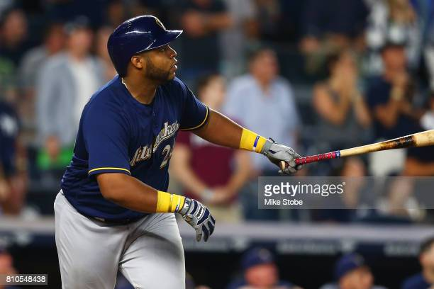 Jesus Aguilar of the Milwaukee Brewers hits a grand slam in the seventh inning against the New York Yankees at Yankee Stadium on July 7 2017 in the...