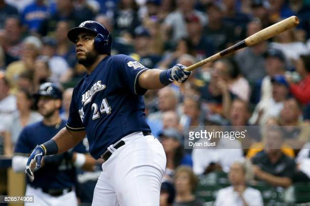 Jesus Aguilar of the Milwaukee Brewers hits a home run in the third inning against the St Louis Cardinals at Miller Park on August 3 2017 in...