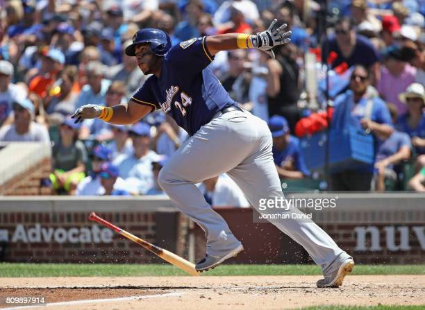 Jesus Aguilar of the Milwaukee Brewers hits a single in the 3rd inning against the Chicago Cubs at Wrigley Field on July 6 2017 in Chicago Illinois