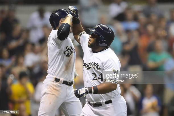 Jesus Aguilar of the Milwaukee Brewers is congratulated by Ryan Braun following a two run home run during the eighth inning against the St Louis...