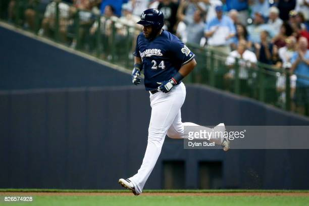 Jesus Aguilar of the Milwaukee Brewers rounds the bases after hitting a home run in the third inning against the St Louis Cardinals at Miller Park on...