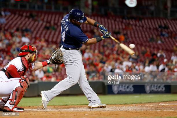 Jesus Aguilar of the Milwaukee Brewers takes an at bat during the game against the Cincinnati Reds at Great American Ball Park on September 5 2017 in...