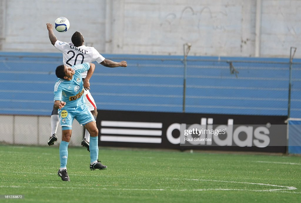 Jesus Alvarez of Sporting Cristal fights for the ball with Jhonnier Monta–o of San Martin during a match between Sporting Cristal and San Martin as part of The 2013 Torneo Descentralizado at the Alberto Gallardo Stadium on February 09, 2013 in Lima, Peru