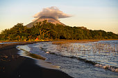 Jesus and Mary beach on island Ometepe in Lake Nicaragua with volcano Conception in background, Nicaragua in Central America. Volcano Conception is one of the most perfectly shaped volcanos of the Ame