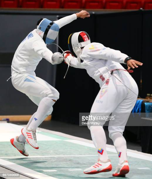 Jesus Andres Lugones Ruggeri of Argentina fences against Francisco Limardo of Venezuela during the gold medal match of the Team Men's Epee event on...